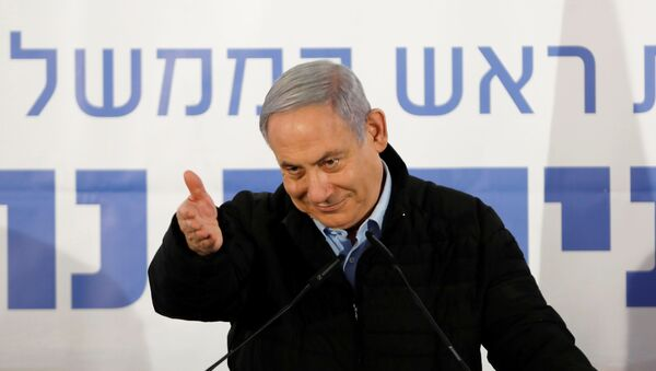 Israeli Prime Minister Benjamin Netanyahu gestures as he speaks during an event marking Tu BiShvat, the Jewish Arbor Day, in the Israeli settlement of Mevo'ot Yericho, in the Israeli-occupied West Bank February 10, 2020.  - Sputnik International