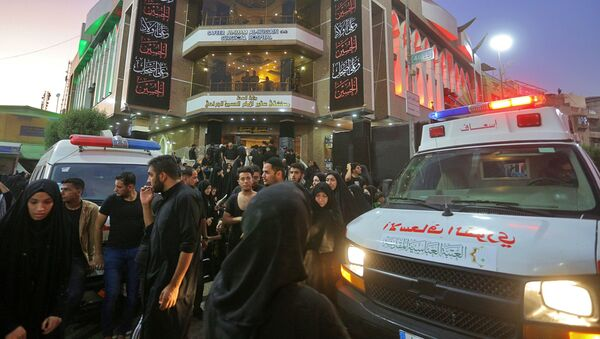 People gather outside a hospital while ambulances bring injured people after a walkway collapsed and set off a stampede as thousands of Shiite Muslims marked one of the most solemn holy days of the year in the holy city of Karbala, Iraq, Tuesday, Sept. 10, 2019 - Sputnik International