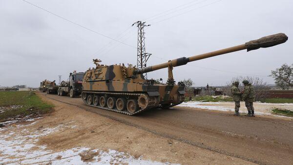 Turkish military convoy is seen near the town of Idlib, Syria, Wednesday, Feb. 12, 2020 - Sputnik International