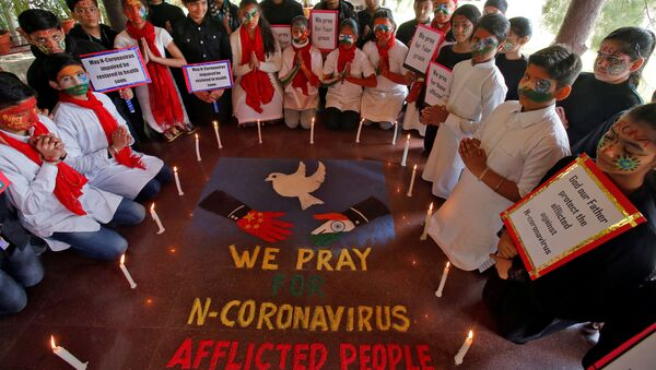 Students pray for the victims of coronavirus at a school in Chandigarh, India, January 31, 2020 - Sputnik International