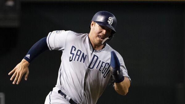 Ty France #11 of the San Diego Padres rounds third base to score against the Arizona Diamondbacks in the sixth inning of the MLB game at Chase Field on September 28, 2019 in Phoenix, Arizona. - Sputnik International
