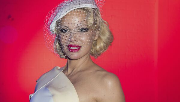 Actress Pamela Anderson attends the Vivienne Westwood Ready To Wear Spring-Summer 2020 collection, unveiled during the fashion week, in Paris, Saturday, Sept. 28, 2019 - Sputnik International