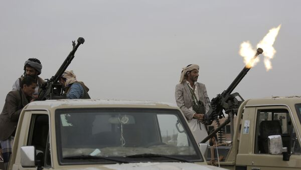 A Houthi rebel fighter fires in the air during a gathering aimed at mobilizing more fighters for the Houthi movement, in Sanaa, Yemen - Sputnik International