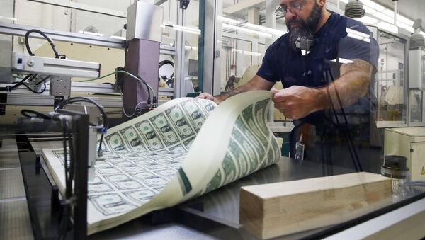 FILE- In this Nov. 15, 2017, file photo, a worker aerates printed sheets of dollar bills at the Bureau of Engraving and Printing in Washington.  - Sputnik International
