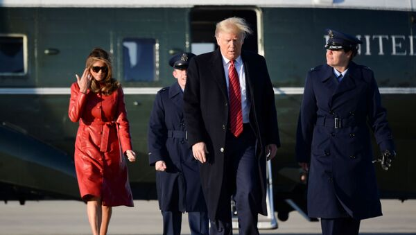 U.S. President Donald Trump and first lady Melania Trump walk from Marine One to board Air Force One as they depart Washington for travel to Florida at Joint Base Andrews, Maryland, U.S., February 14, 2020. - Sputnik International