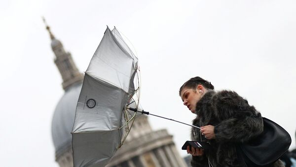 A woman struggles with an umbrella as she walks in front of St Paul's Cathedral during storm Dennis in London, Britain, February 15, 2020.  - Sputnik International