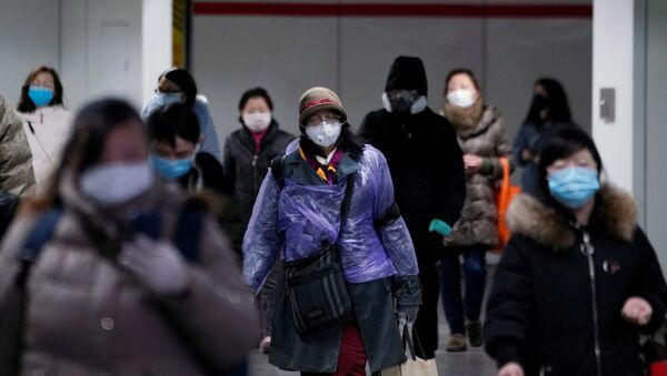 People wearing face masks walk inside a subway station, as the country is hit by an outbreak of the novel coronavirus, in Shanghai, China February 17, 2020. - Sputnik International