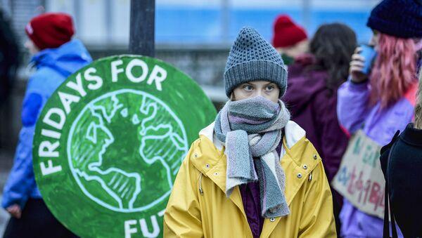 Swedish environmental activist Greta Thunberg attends a climate strike arranged by the organisation Fridays For Future outside the Swedish parliament Riksdagen in Stockholm, December 20, 2019. (Photo by Pontus LUNDAHL / TT News Agency / AFP) / Sweden OUT - Sputnik International