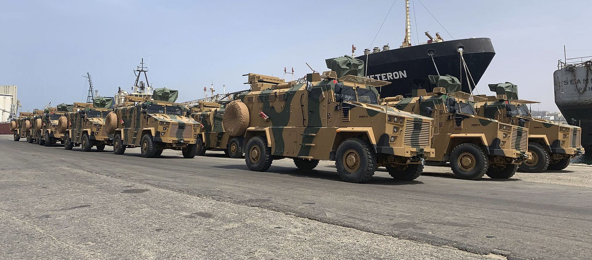 A photo posted on the Facebook Page of the media bureau of Volcano of Anger operation on May 18, 2019, reportedly shows Turkish-made armoured personnel vehicles, shipped to Libya's internationally recognised Government of National Accord (GNA), arriving at Tripoli port - Sputnik International, 1920, 17.02.2020