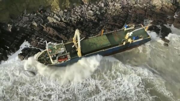 Undated image released Monday Feb. 17, 2020, by Irish Coast Guard showing an abandoned cargo ship the MV Alta, that has washed up on the coast of County Cork, near Ballycotton, southern Ireland.  The MV Alta is believed to have had 10 crew members aboard who were rescued by the US Coast Guard.  Since September 2018, the ship has been drifting with no crew aboard, and it was last seen off the coast of West Africa before being washed up in southern Ireland during Storm Dennis. - Sputnik International