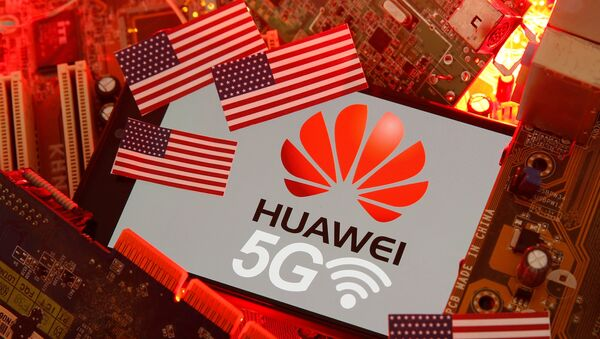The U.S. flag and a smartphone with the Huawei and 5G network logo are seen on a PC motherboard in this illustration taken January 29, 2020 - Sputnik International