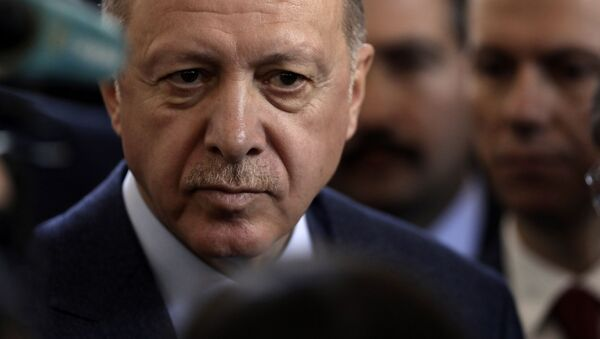 Turkish President Recep Tayyip Erdogan speaks to journalists at parliament, in Ankara, Turkey, Wednesday, Feb. 19, 2020. Erdogan said on Wednesday that time was running up for Syrian government forces to retreat from Syria's northwestern Idlib province and warned of an imminent Turkish intervention to force the retreat. - Sputnik International