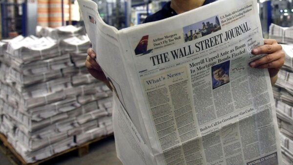 ** FILE ** In this April 16, 2008 file photo, printer Belinda Affat poses for photographs with a copy of the Wall Street Journal at a printing press in London.  A year into its takeover by Rupert Murdoch's News Corp., The Wall Street Journal is evolving under what its new editor calls incremental radicalism.  Steeped in tradition, the 119-year-old newspaper has expanded its coverage beyond corporate America, placed more breaking stories on the front page and increased the size of photos and graphics. (AP Photo/Matt Dunham, file) - Sputnik International