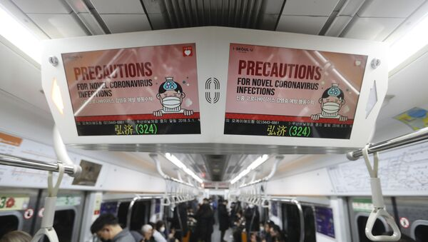 Electric screens about precautions against the illness COVID-19 are seen in a subway train in Seoul, South Korea, Monday, Feb. 17, 2020. Chinese authorities on Monday reported a slight upturn in new virus cases and 105 more deaths for a total of 1,770 since the outbreak began two months ago - Sputnik International