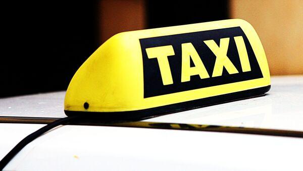 A taxi roof sign - Sputnik International