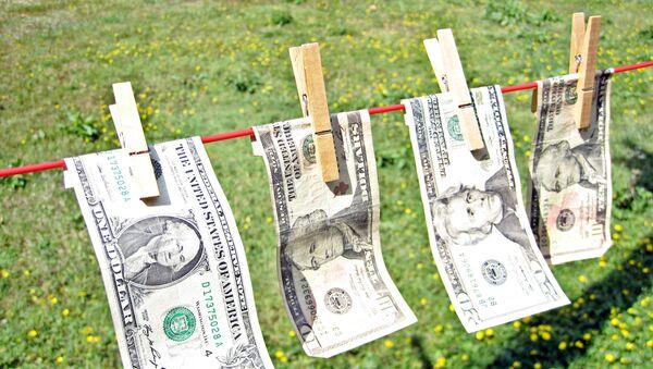 Laundering dollar bills - Sputnik International