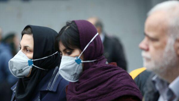Iranian women wearing protective masks to prevent contracting a coronavirus as they walk at Grand Bazaar in Tehran, Iran February 20, 2020. - Sputnik International