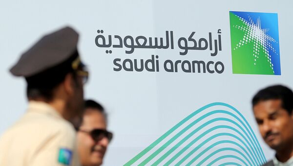 The logo of Aramco is seen as security personnel stand before the start of a press conference by Aramco at the Plaza Conference Center in Dhahran, Saudi Arabia November 3, 2019 - Sputnik International