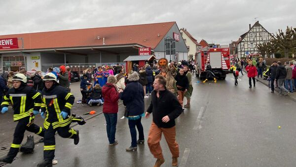 People react at the scene after a car ploughed into a carnival parade injuring several people in Volkmarsen, Germany February 24, 2020 - Sputnik International