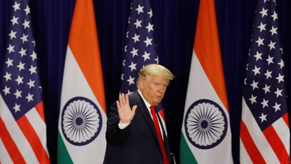 U.S. President Donald Trump waves as he leaves after a news conference in New Delhi, India, February 25, 2020 - Sputnik International