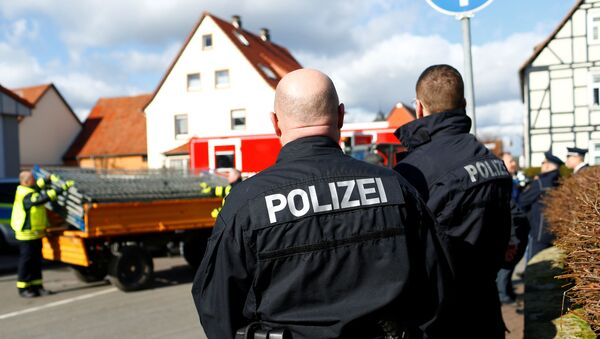 Police officers stand near the crash site, the day after a car ploughed into a Carnival parade, injuring several people in Volkmarsen, Germany February 25, 2020 - Sputnik International