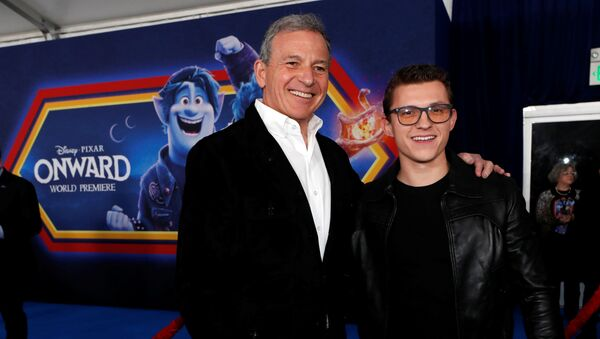 Cast member Tom Holland and Bob Iger, CEO of the Walt Disney Company, pose at the premiere for the film Onward in Los Angeles, California, U.S. February 18, 2020.  - Sputnik International