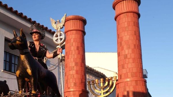 A woman is seen standing on a carnival float depicting Third Reich eagle symbol, Menorah candle holder and crematorium chimneys, during a carnival parade in Campo De Criptana, Ciudad Real Province, Spain February 24, 2020 in this picture obtained from social media - Sputnik International