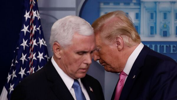 U.S. President Donald Trump walks past Vice President Mike Pence during a news conference at the White House in Washington, U.S., February 26, 2020.  REUTERS/Carlos Barria - Sputnik International