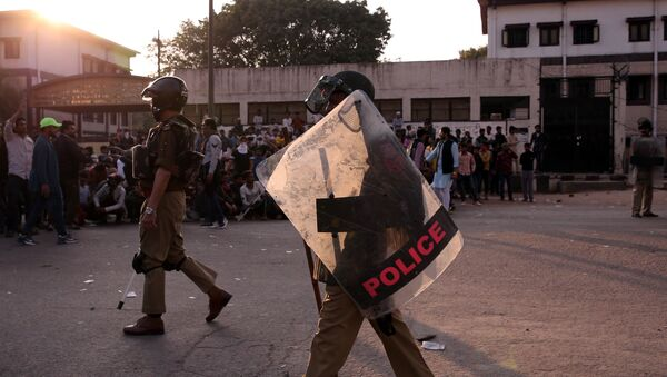 Policemen patrol in a riot affected area after clashes erupted between people demonstrating for and against a new citizenship law in New Delhi, India, February 25, 2020.  - Sputnik International