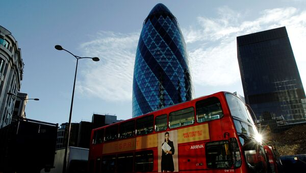 An Arriva bus passes the Swiss Re building in the City of London - Sputnik International