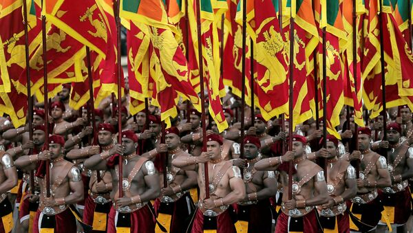 Sri Lanka's military march with national flags during the 72nd independence day ceremony, in Colombo, Sri Lanka February 4, 2020 - Sputnik International