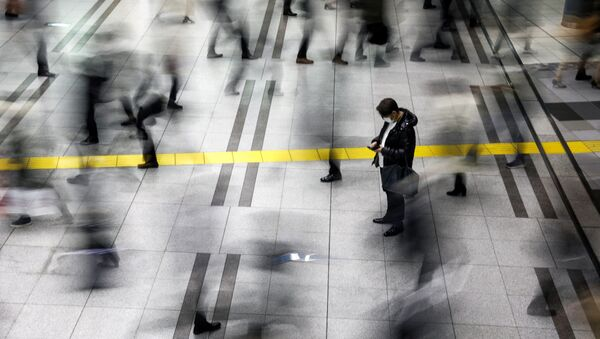 A man wearing a protective face mask, following an outbreak of the coronavirus, stands at the Shinagawa station in Tokyo, Japan, February 28, 2020. REUTERS/Athit Perawongmetha - Sputnik International