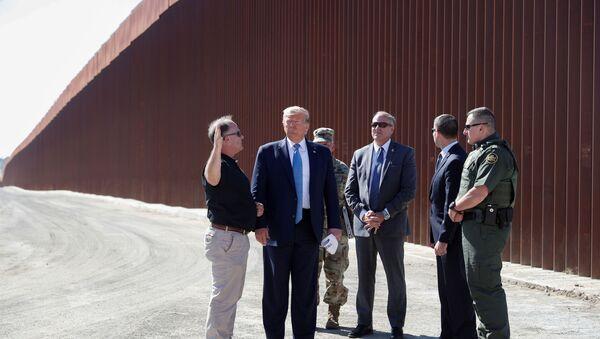 FILE PHOTO: U.S. President Donald Trump visits a section of the U.S.-Mexico border wall in Otay Mesa, California, U.S. September 18, 2019. REUTERS/Tom Brenner/File Photo - Sputnik International