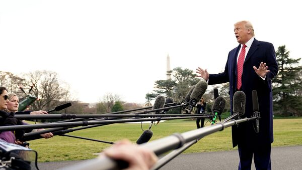 U.S. President Donald Trump talks to reporters as he departs on campaign travel to Charleston, South Carolina from the South Lawn of the White House in Washington, U.S.,  February 28, 2020. REUTERS/Kevin Lamarque - Sputnik International