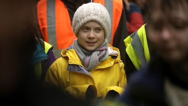 Climate activist Greta Thunberg, from Sweden marches with other demonstrators as she participates in a school strike climate protest in Bristol, south west England, Friday, Feb. 28, 2020. - Sputnik International