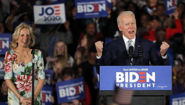 Democratic presidential candidate former Vice President Joe Biden, accompanied by his wife Jill Biden, speaks at a primary night election rally in Columbia, S.C., Saturday, Feb. 29, 2020. - Sputnik International