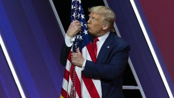 President Donald Trump kisses the American flag after speaking at Conservative Political Action Conference, CPAC 2020, at the National Harbor in Oxon Hill, Md., Saturday, Feb. 29, 2020. - Sputnik International