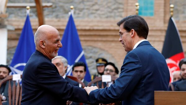 Afghanistan's President Ashraf Ghani shakes hands with U.S. Defense Secretary Mark Esper, during a news conference in Kabul, Afghanistan February 29, 2020.  - Sputnik International