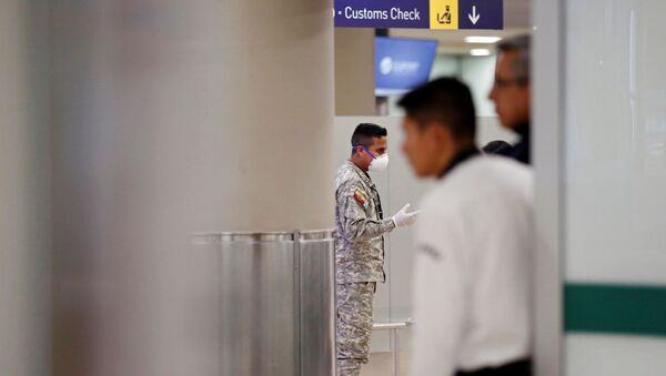 A soldier wears a surgical mask at the Mariscal Sucre International Airport, after the first case of a fast-spreading new coronavirus was confirmed in the country, in Quito, Ecuador February 29, 2020. REUTERS/Daniel Tapia - Sputnik International