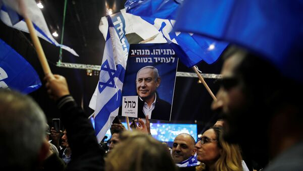 Supporters react as results of the exit polls in Israel's elections are announced at Israeli Prime Minister Benjamin Netanyahu's Likud party headquarters in Tel Aviv, Israel March 2, 2020 - Sputnik International