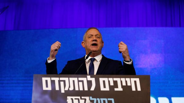Blue and White party leader Benny Gantz gestures as he speaks to supporters following the announcement of exit polls in Israel's election at the party's headquarters in Tel Aviv, Israel March 3, 2020 - Sputnik International
