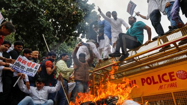 Activists of the youth wing of India's main opposition Congress party show slogans during a protest demanding the resignation of Home Minister Amit Shah following last week's clashes between people demonstrating for and against a new citizenship law in New Delhi, India March 2, 2020.  - Sputnik International