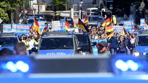 AfD supporters walk accompanied by police cars in Erfurt, Germany, Wednesday, May 1, 2019. The Alternative for Germany launches its European parliament election campaign in the eastern city of Erfurt. - Sputnik International
