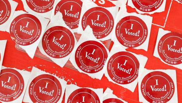 """A table of """"I voted!"""" stickers are seen at a polling station as voters cast their ballots for the presidential primary election on Super Tuesday in San Francisco, California, U.S. March 3, 2020 - Sputnik International"""