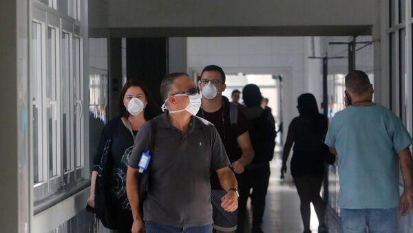 Locals wear masks inside Talca regional hospital in Talca, Chile - Sputnik International
