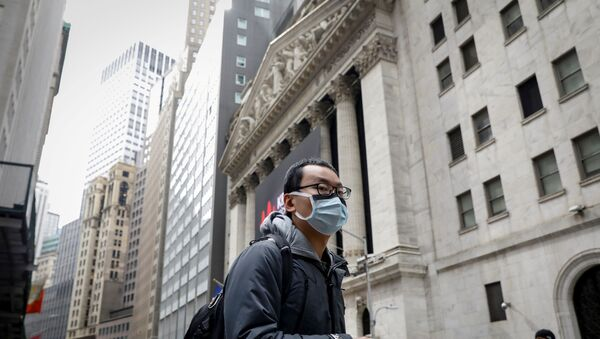 A man wears a mask on Wall St. near the New York Stock Exchange (NYSE) in New York, U.S., March 3, 2020 - Sputnik International