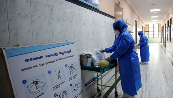 FILE PHOTO: Medical staff with protective clothing are seen inside a ward specialised in receiving any person who may have been infected with coronavirus, at the Rajiv Ghandhi Government General hospital in Chennai, India, January 29, 2020. - Sputnik International