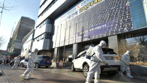 Workers from a disinfection service company sanitize a street in front of a branch of the Shincheonji Church of Jesus the Temple of the Tabernacle of the Testimony where a woman known as Patient 31 attended a service in Daegu, South Korea, February 19, 2020 - Sputnik International