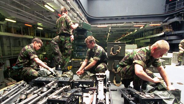British Royal Marines from the 42nd Commando unit  check their equipment on the British Royal Navy helicopter carrier HMS Ocean in Marseille Sunday May 7, 2000 - Sputnik International