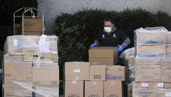 A worker organizes a delivery at the Life Care Center of Kirkland, the long-term care facility linked to several confirmed coronavirus cases in the state, in Kirkland, Washington, U.S. March 4, 2020 - Sputnik International
